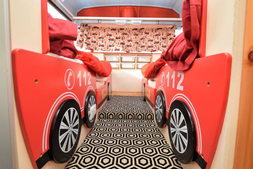 two red fire truck beds