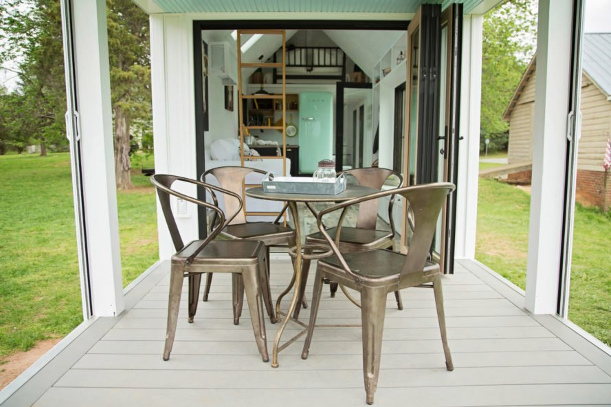 bronze chairs and table on small porch