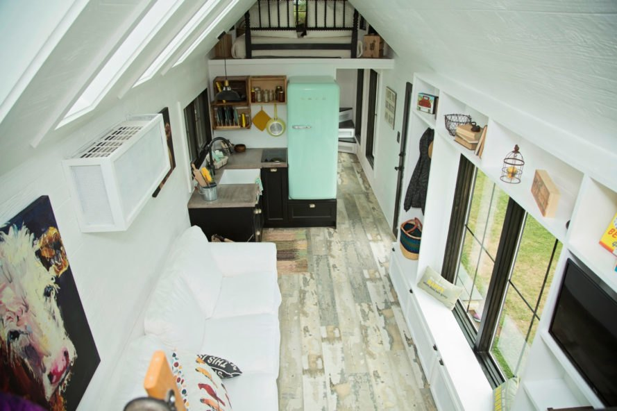 aerial view of tiny home with white walls and kitchen with blue SMEG fridge