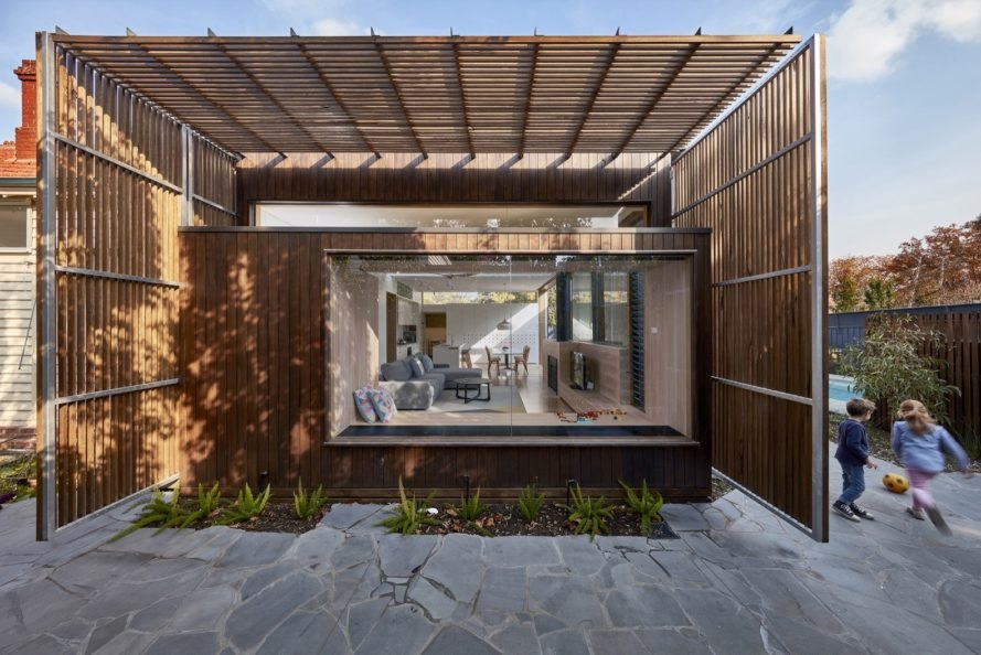 home with glazed end wall surrounded by timber screens
