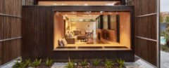 home surrounded by large timber screens