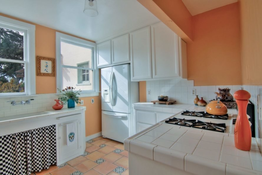 kitchen with orange walls and white ceramic countertops