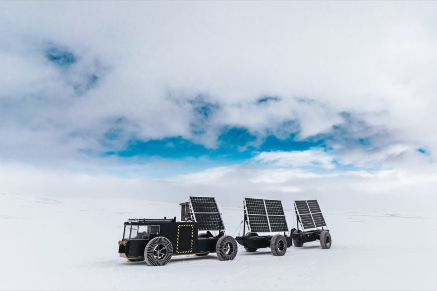 black solar-powered vehicle on snowy landscape