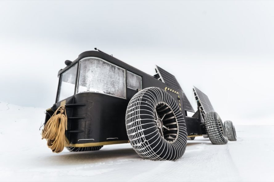 black solar-powered vehicle on snow