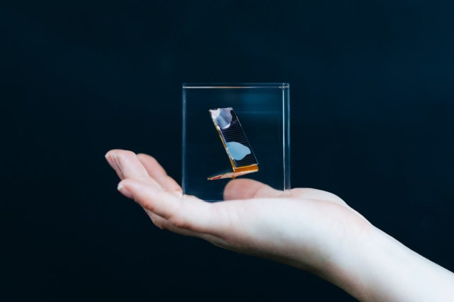 person holding glass cube