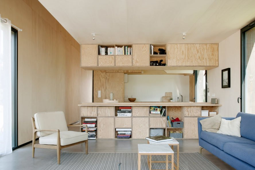 living space with seating and kitchen in the background