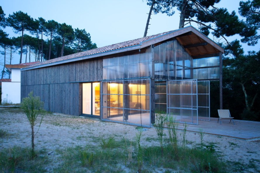 timber home with transparent front porch
