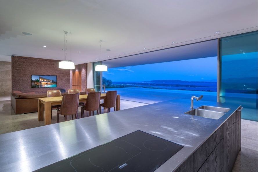 kitchen countertop with open glass facade in the distance