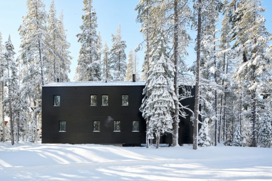 large black home in snowy landscape