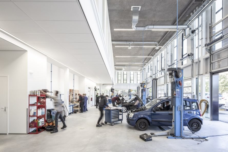 people working on cars in a workshop