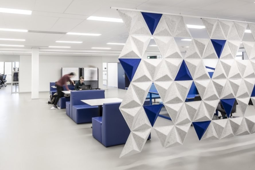 study area with blue furniture and geometric white and blue room divider