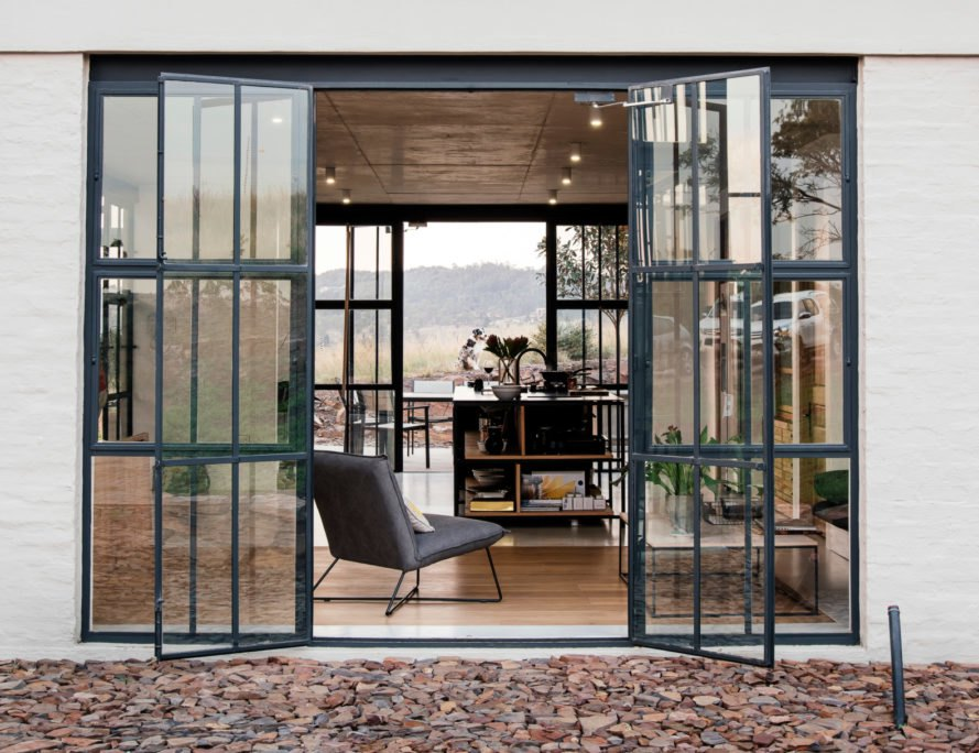 glass french doors opening to ktichen