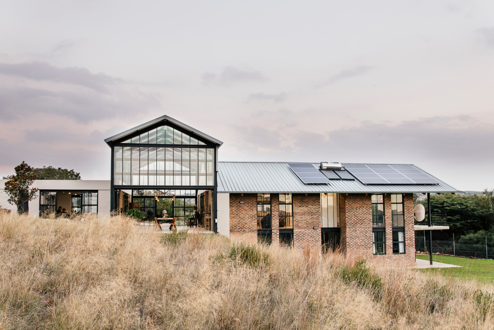 An off-grid home in South Africa features a conservatory for fully enjoying nature