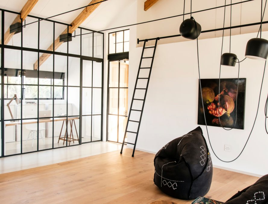 all glass wall and living space with ladder and bean bag