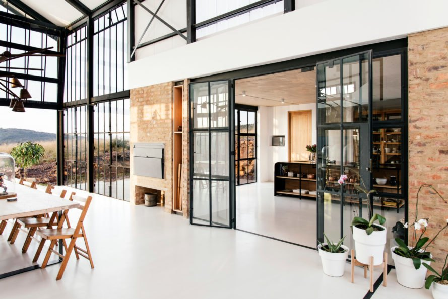 room with brick walls and glass doors
