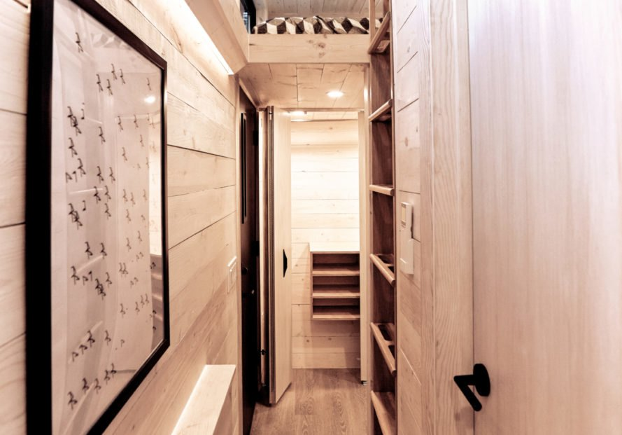 wooden hallway with shelving