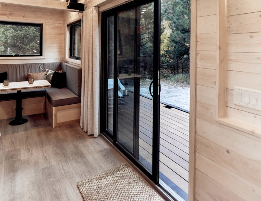 sliding glass doors leading from living area to outdoor deck