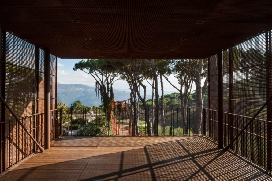 porch with metal screens overlooking mountains