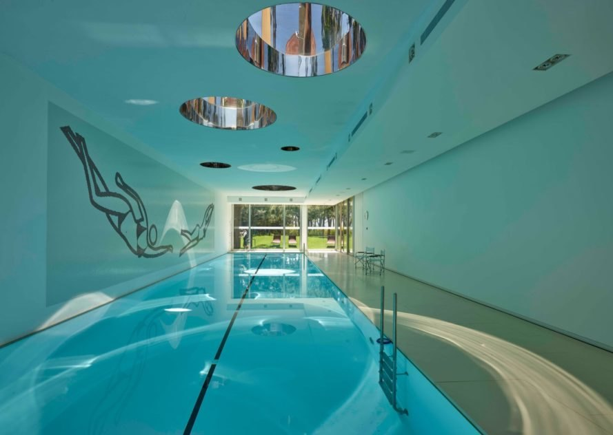 indoor pool in room with light blue walls