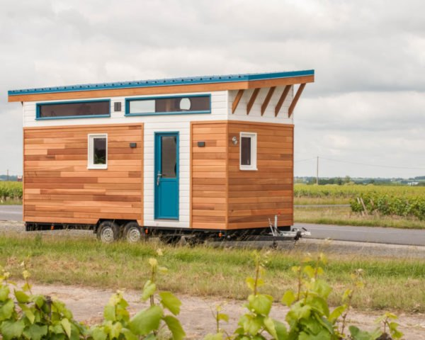 tiny home clad in cedar panels with white trim