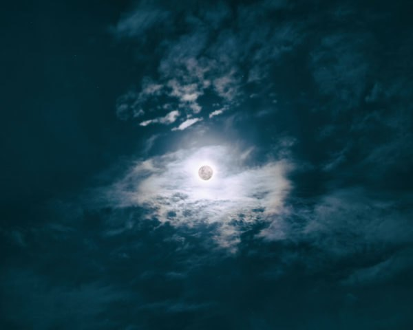 bright moon in a cloudy sky