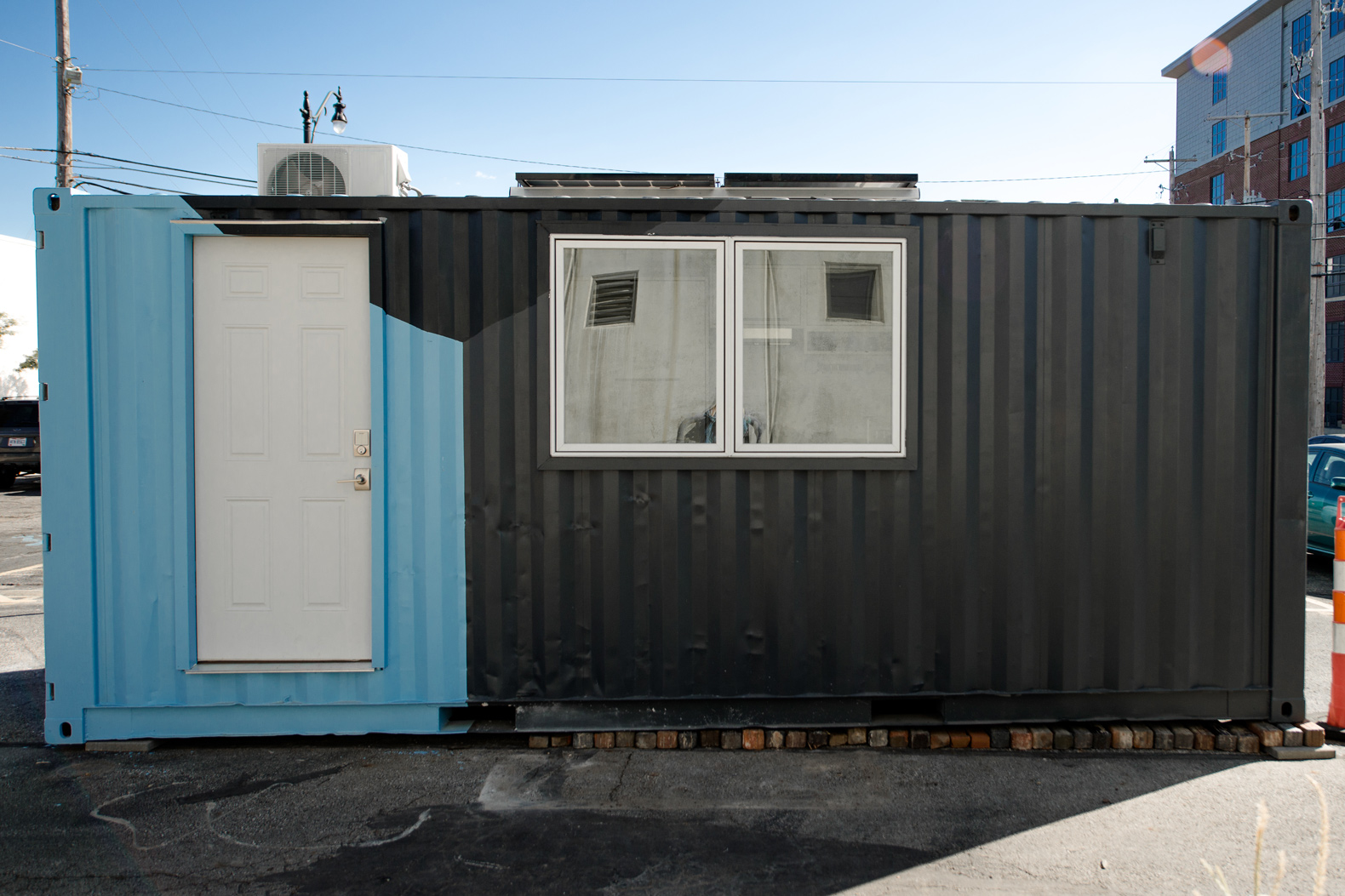This tiny shipping container home adapts to your needs