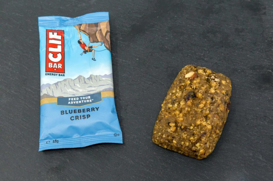 A blueberry nutrition bar next to its wrapper