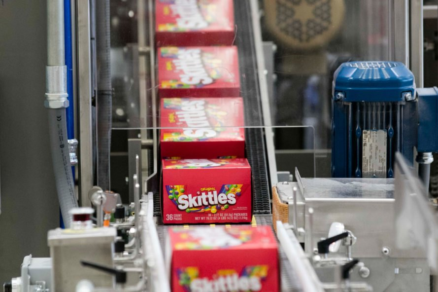 boxes of Skittles on a production line