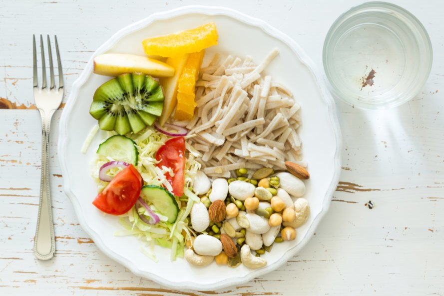 fruits and vegetables on a small white plate