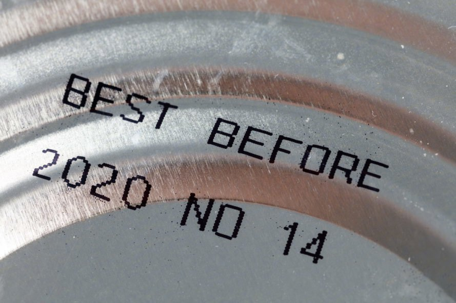 close-up of 'best before' date on the bottom of a can