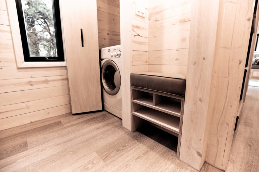 wood-clad interior with washing machine