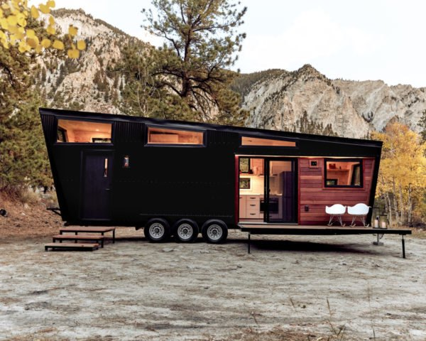 black RV with windows and front deck