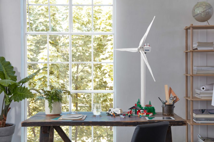 wind turbine and cottage all made from LEGOs on a dining table