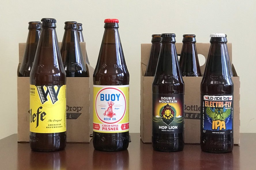 "local Oregon beers in refillable bottles with ""BottleDrop"" and ""Refillable"" imprinted into the bottles"