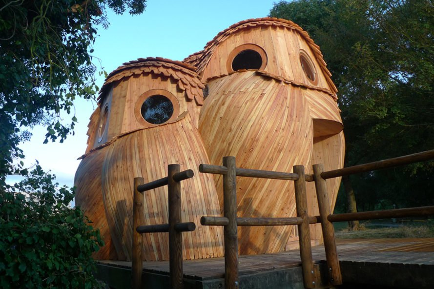 wooden tiny home in the shape of two owls