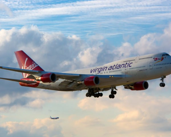Virgin Atlantic airplane flying in cloudy skies