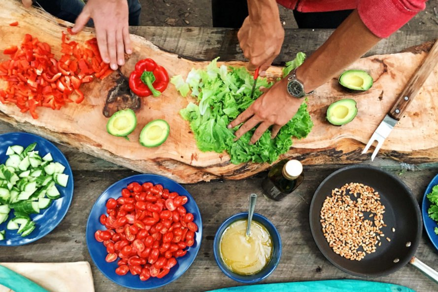 aerial view of two people chopping fresh vegetables