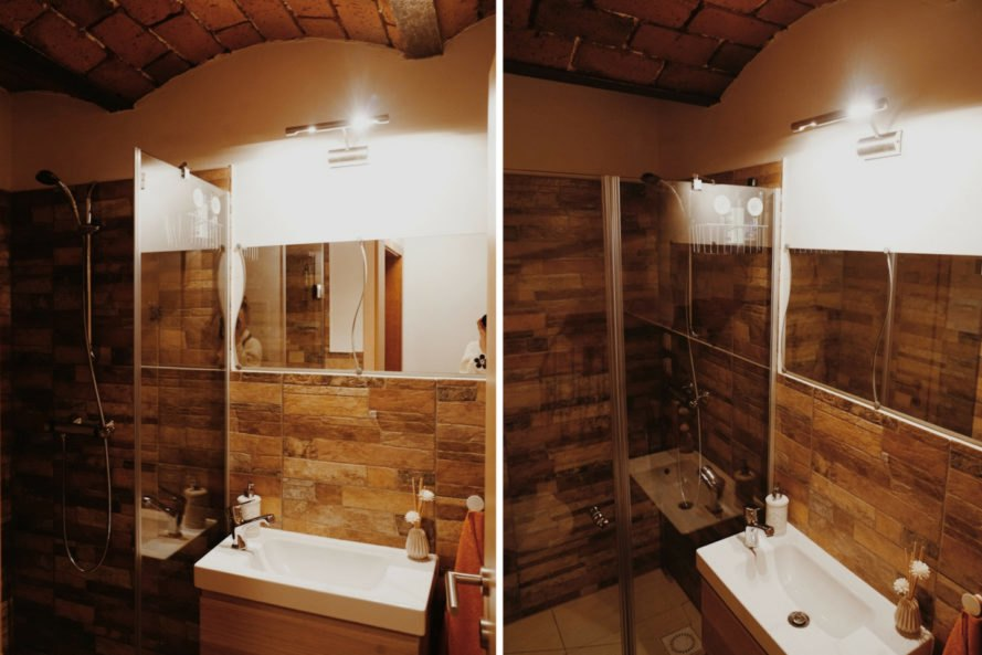 bathroom with wood walls and large sink