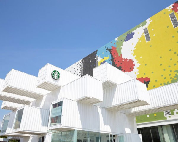 stacked white shipping containers with a starbucks logo