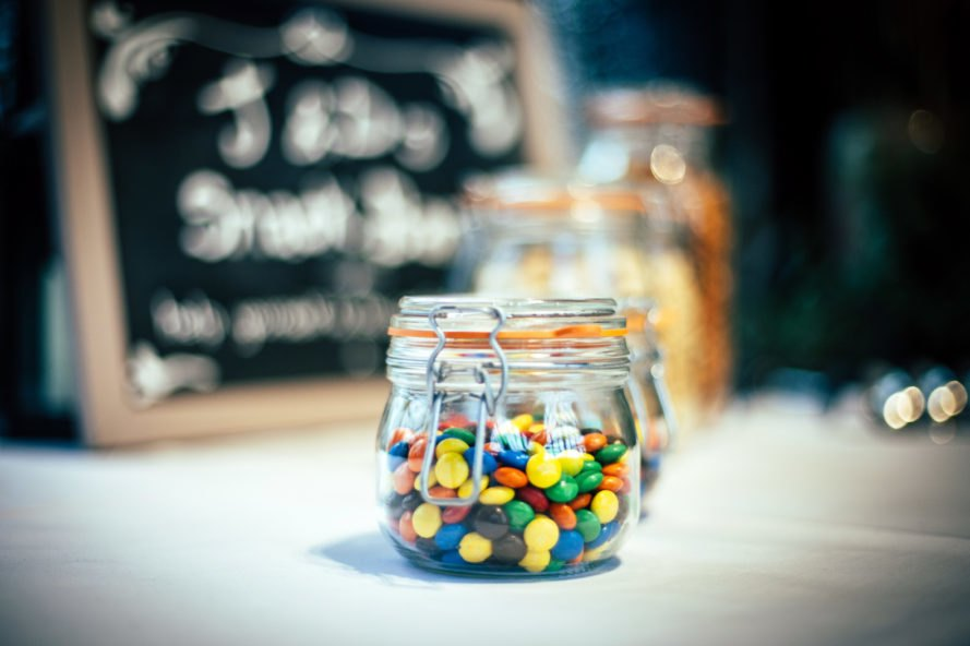glass jars with clamp lids filled with candy