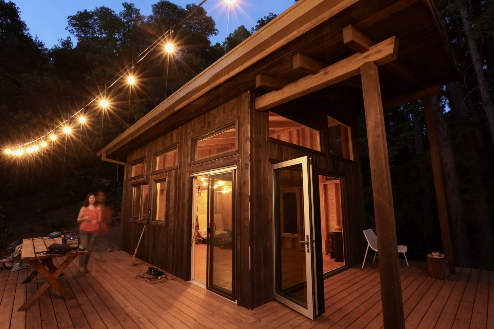 Group of friends build a DIY cabin retreat, complete with suspended tree decks