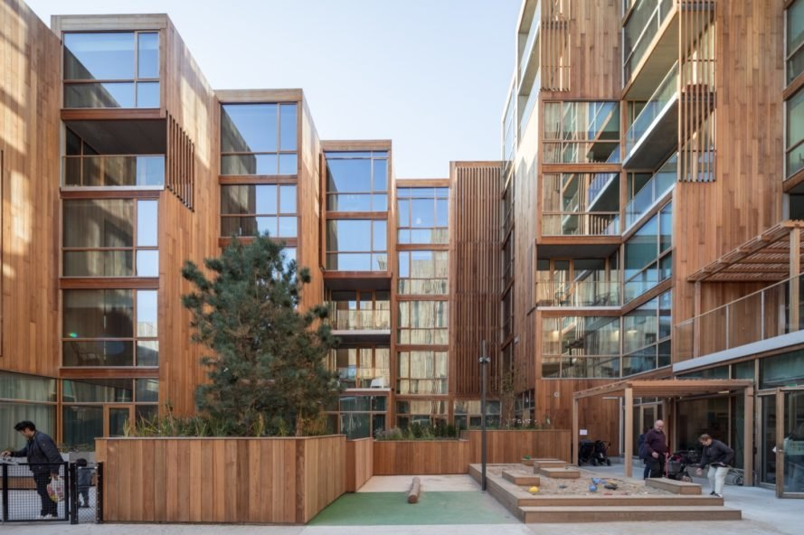 open courtyard in the middle of timber apartment buildings