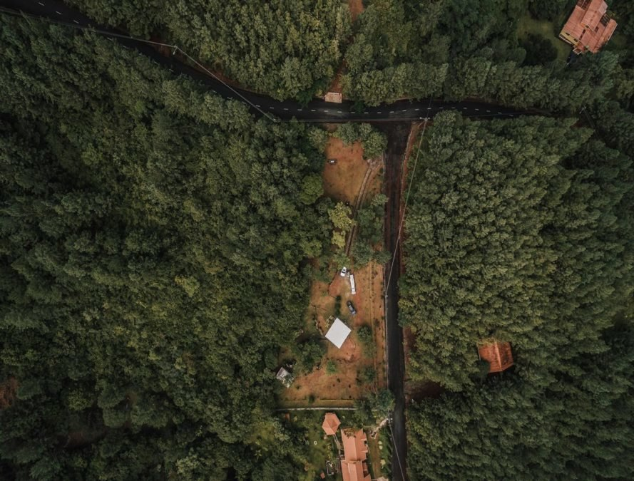 aerial view of cabin in a forest