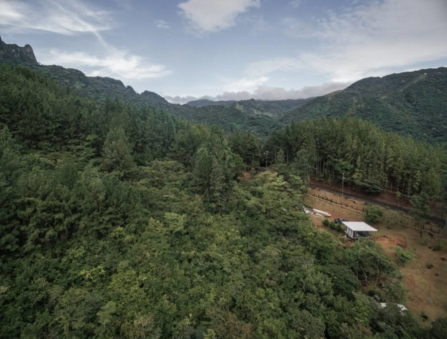 aerial view of cabin surrounded by trees