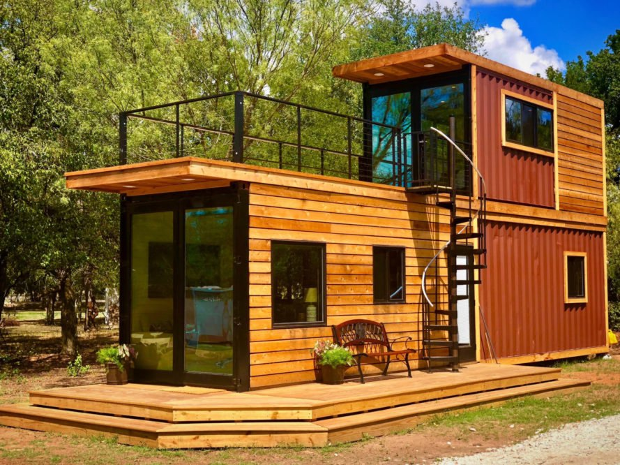 This tiny home with a rooftop deck is made from two shipping ... Railroad Containers Houses Plans on railroad freight houses, railroad construction houses, railroad home, railroad box houses, railroad boxcar houses,