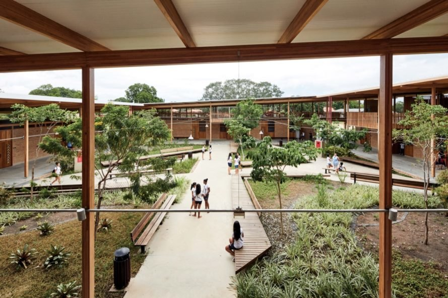 children on walkway surrounded by plants