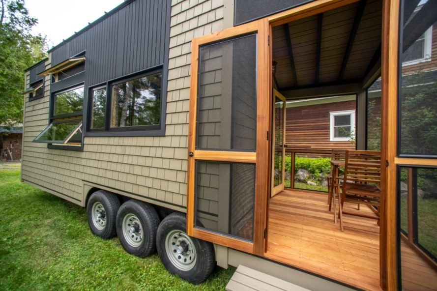 tiny home on wheels with screened in porch
