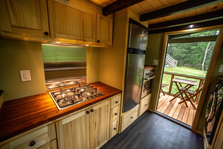 kitchen with wooden cabinets and door leading out to deck
