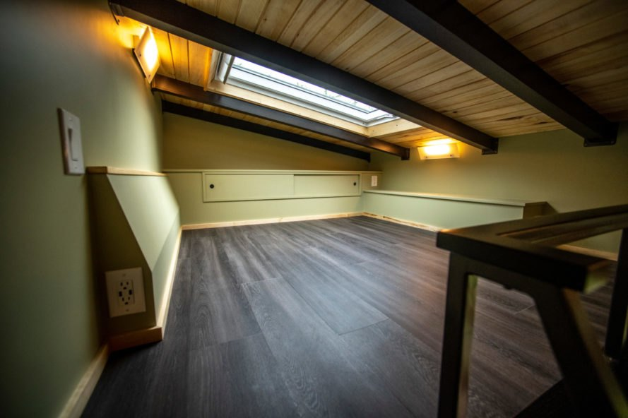 wooden sleeping loft with skylight