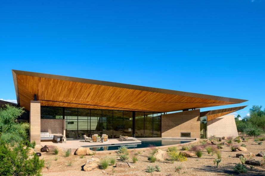 rammed earth home with pool